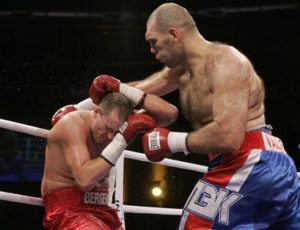 Nikolai Valuev from Russia, right, and Jean Francois Bergeron from Canada box in an NABA Heavyweight title fight in Oldenburg, northern Germany, on Saturday, Sept. 29, 2007.Valuev defeated Bergeron with a majority decision after a 12-round bout to claim the title. (AP Photo/Joerg Sarbach)